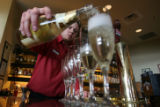 DLM6296  Bartender Chris Vincent pours up a row of mamosas at the Ship Rock Grille in the Red...