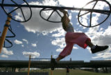 Emma Markovich, 5  plays on the monkey bars after a meeting held by the  newly-formed group,...