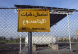 "A ""No Smoking"" sign hangs on a fence at Iran's nuclear enrichment facility in Natanz,..."