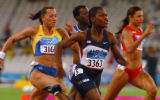 (Athens, Greece  on Friday, Aug. 20, 2004) - American sprinter Lauryn Williams, center, leads...