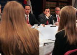 Embattled U.S. Attorney Alberto Gonzales , hand on face,  gets opinions from students, back to...