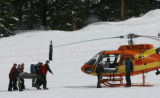 MJM711 An injured adolescent male is transported to a Flight For Life helicopter Monday at A Basin...