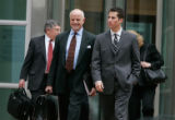 Nacchio's lawyer John Richilano (l) and Michael Nacchio (r) leave in the 2nd week of trial for...