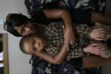 DeUndre WIlliams, 7, and his mother Gina in their home. (STEVEN R NICKERSON/ROCKY MOUNTAIN NEWS)...