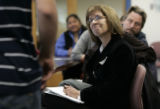 Pat Olive (cq) (r) listens to a student from The Denver Center For International Studies, talk...
