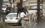 Denver Police Homicide Detectives investigate a dumpster containing a body in the 200 block of the...