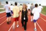 The Fox family has a long track tradition at Fort Collins High School. Coach Laurie Rice (cq)...