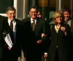 Former Qwest CEO Joseph Nacchio, center, walks out with his wife Anne Esker (cq) right, along with...