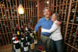 John and Trish Morphew-Lewis (Cq) in their wine cellar in Boulder on March 27, 2007. Like many...