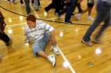 (Denver, Colo., August 16, 2004) Freshman student Jorge Garcia-Cervantes sits on the floor and...