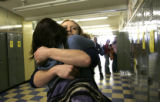 Before heading to practise, Joy Nameth, 18 hugs her best friend and fellow senior Josie Goulette...