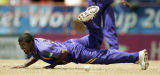 ACWC103 - Sri Lanka's Muttiah Muralitharan dives to stop the ball against New Zealand during the...
