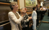 0069 The States First Lady Jeannie Ritter applauds Colorado teachers as the State legislature...