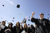 Students from the School of Architecture threw their graduation caps in the air after the...