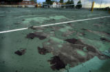 (DENVER, CO., AUGUST 31, 2004) The tennis court coating is disintegrating from neglect, on the...