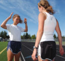 ** Special for the Rocky Mountain News** Running coach Melody Fairchild talks to high school track...