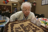 Helen Knutson, (cq) celebrates her 100th birthday with family and friends at Total Longterm Care...