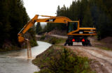 (GRAND DITCH Colo., June 30, 2004)   Larry Stegeman uses a Cat 318 to clear out sediment from the...