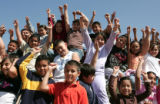 Third graders at Beach Court Elem. have a lot to cheer about as they gather on the playground ...
