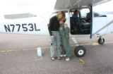Julian Willis, (cq), 10, gets a happy hug from his mom JoAnne Willis after he hopped out of the...