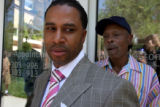 Andre Holliday (cq) ,left, with his father, Oscar Holliday (cq) ,right, opens his store , Clothing...