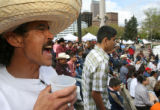 41 year-old Efrain Coronado (cq) sings along during a concert at the Civic Center Park on May 6,...
