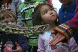 (from left) 2 year-olds Benjamin Smart (cq) and Miriam Gonzales  (cq) check out an anaconda at the...