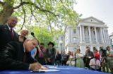 Governor Bill Ritter signs House Bill 1069 at the Capitol in Denver, Colo., on Thursday, May 3,...