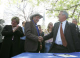 Governor Bill Ritter, right,  shakes the hand of State Rep. Wes McKinley after Ritter signed House...