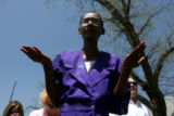 Kenidra Myers (cq), of Aurora, takes part in the National Day of Prayer, Thursday afternoon, May...