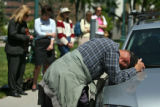 Don Bouma (cq), of Denver, leans on a car while praying during   National Day of Prayer, Thursday...