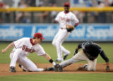 PNC102 - Arizona Diamondbacks shortstop Stephen Drew, left, tags out Colorado Rockies' Willy...