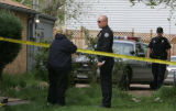 JOE002 Mary Brunkow (cq), left, talks to a police offficer investigating on Monday morning, May 7,...