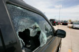 An Izuzu Rodeo with its windows broken out  is 1 of about 40 vehicles vandalized overnight at the...