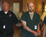 Frank Schilt (cq) is led into Denver District  Court Monday May 7,2007. Schilt pled guilty to...
