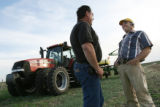 MJM1083  Sales Manager for Farmers Implement Co. Inc., Arick Davis (cq), center, talks with farmer...