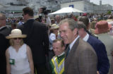 George W. Bush stands with jockey Pat Day in the paddock at the 126th   running of the Kentucky...