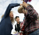 Photo by Dean--Volunteer extraordinaire Donna Herod replaces  Judy Hagan's hat after the wind blew...