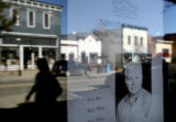 Main Street in downtown Breckenridge is reflected in a storefront window displaying a missing...