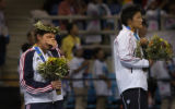 (Athens, Greece  on Monday, Aug. 23, 2004) - American silver medalist wrestler Sarah McMann, left,...