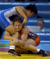 (Athens, Greece  on Monday, Aug. 23, 2004) - Kaori Icho of Japan, top,  against American silver...