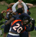 JOE067 Denver Broncos running back Travis Henry stretches during passing camp at the team's...