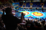 (ATHENS, GREECE-AUGUST 24, 2004) Rulon Gardner's brother, Reynold Gardner, waves an American Flag...