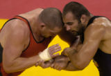 (ATHENS, GREECE-AUGUST 24, 2004) United States' Rulon Gardner, right, of Afton, Wyo., grapples...