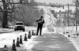 Robert Nuse, an accident reconstuctionist with the Colorado State Patrol, prepares to take...
