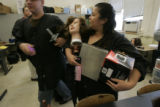 0051 Sonia Luna, CQ, 33, mother of three, works with a mannequin as she attends cosmetology class...