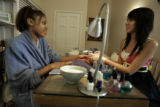 LaToya (she did not want her last name used) (cq) gets a manicure from nail technician Liz Nguyen...