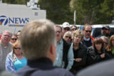 Residents of Breckenridge listen to Breckenridge Police Chief Rick Holman, center, as he tells the...