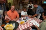 (DENVER, Colo., August 23, 2004) Joe Dreiling, Adams County Deputy Sheriff, reaches for salsa to...
