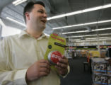 Timothy Bernicke, (cq) District Manager holds one of the stores Easy Buttons at  a new Staples on...